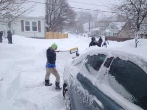 Clearing snow off car